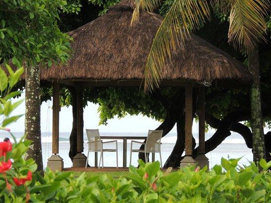 Tamassa: beach restaurant - candle night dinner table