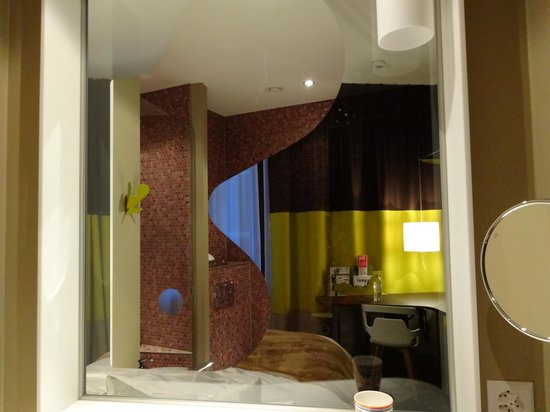25hours Hotel Zürich West: Bathroom with view of bedroom from within.