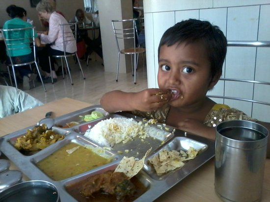 Hope Café: A little one enjoying our Thali lunch....