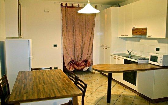 Residence Desiree: Soggiorno/cucina appartamento trilocale Standard