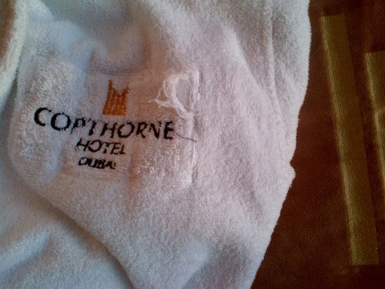 Copthorne Hotel Dubai : Old and torn bathrobes