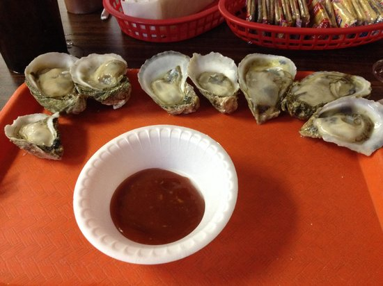 Deal's Famous Oyster House : Half-dozen oysters on the half-shell.  With a couple thrown in.  Big, cold, and shucked before y