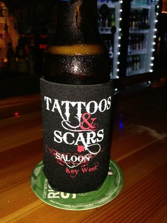 ‪Tattoos & Scars Saloon‬