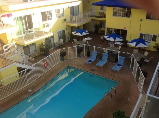 Magic Castle Hotel: View of central pool area from room balcony.