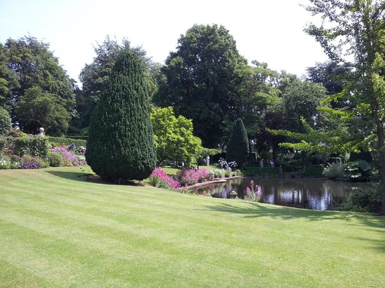 Coton Manor Garden: Looking across the lawn to the pond