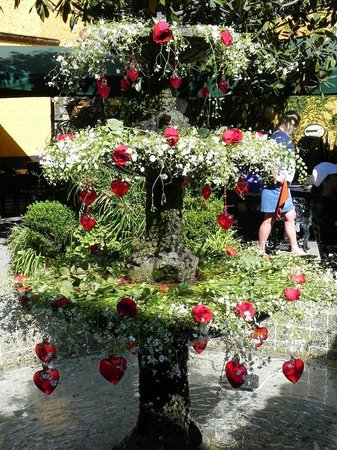 El Patio Tlaquepaque: Courtyard fountain with flowers and red glass hearts for Valentines