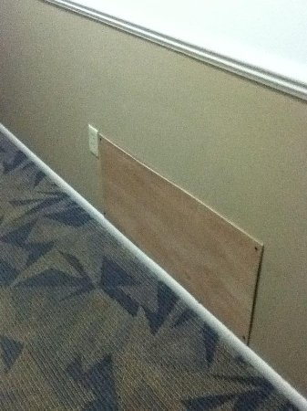 Best Western Milwaukee West: Plywood covering holes in walls and vent spaces