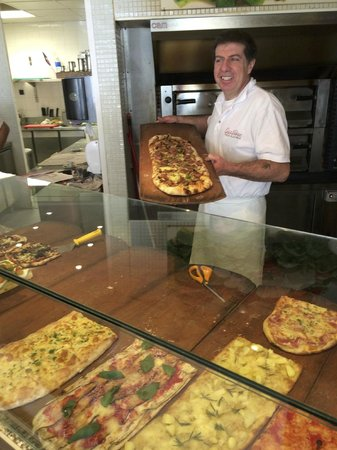 Gastone Pizza Alla Pala: Gianni holding a pizza he's just made