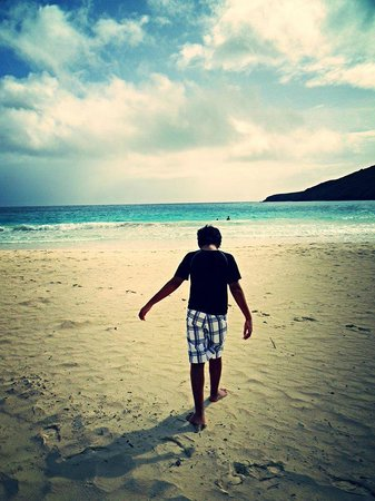 Playa Flamenco: One of my boys getting the feel of the nice white sands on his feet.