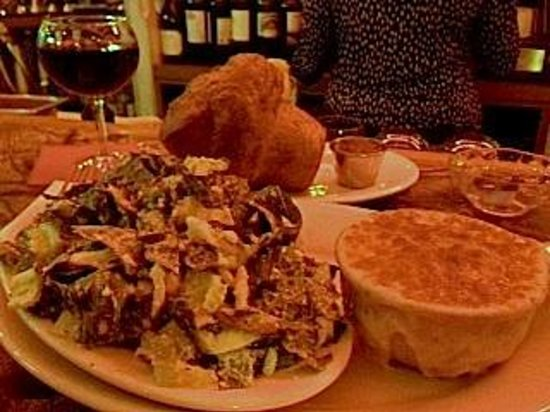 Judie's : Here is my mutant popover with Caesar and onion soup. YUM!