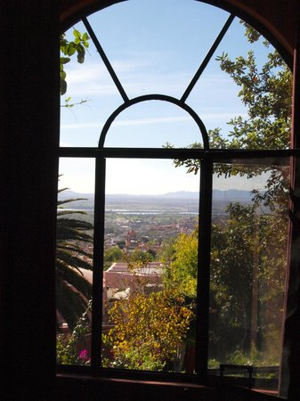 Casa Puesta Del Sol: view out window from the stained glass room