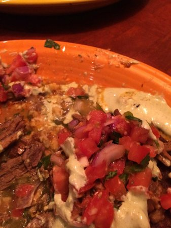 Tio Juan's Margaritas Mexican: SOAKED IN GREASE GRILLED CORN CAKES WITH BRAISED BEEF