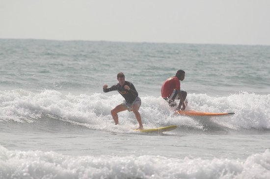 Odysseys Surf School: Teacher Bolan riding close to me after my push start from him!