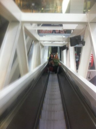 CNN Studio Tours: The tour begins going up the escalator .