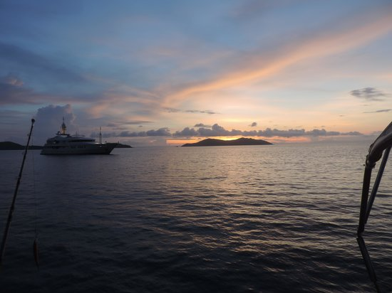 Wayward Wind Charters Fiji: Sunrises on deck are great even though a mega yacht got in the way