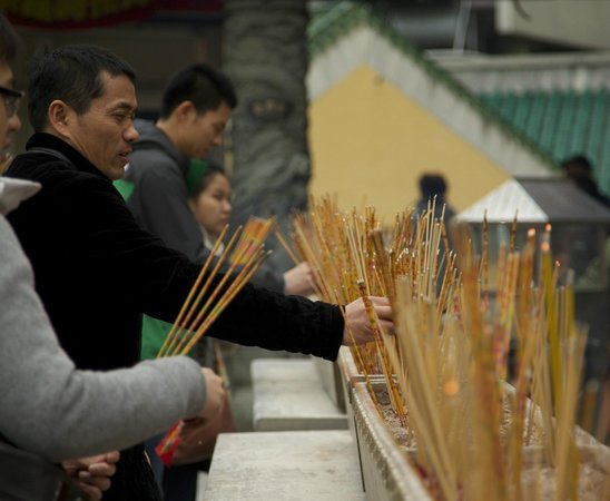 J3 Private Tours Hong Kong: Lighting incense at temple