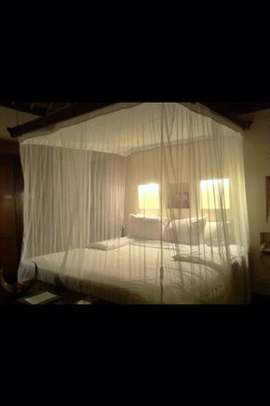 Hanging Gardens of Bali: The bed in the evening.