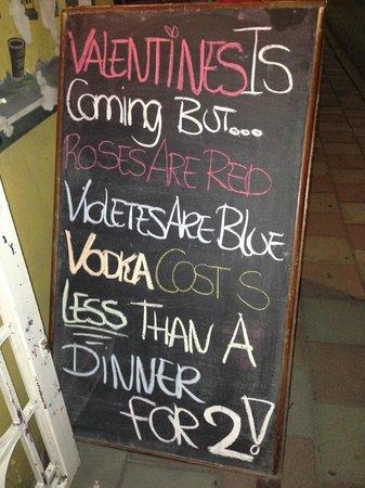 Que Pasa Restaurant Bar & Art Gallery: Street sign before V-day