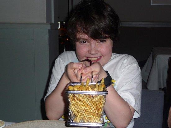 Bang Restaurant: my son shaking micro fryer