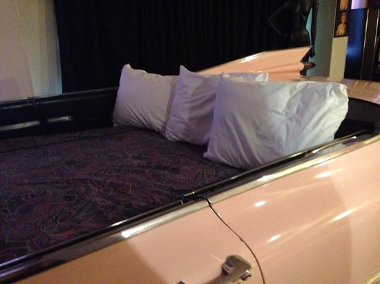 Red Carpet Inn Fantasuites: The bed in the Pink Cadillac. If your tall your feet will hit the dash. Didn't even bother with