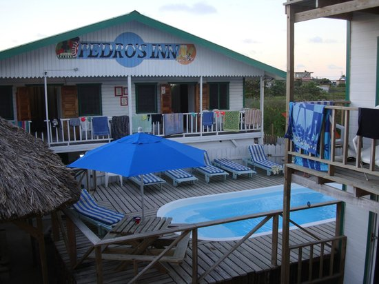 Pedro's Hotel: View from Deluxe room toward one pool and Hostel building