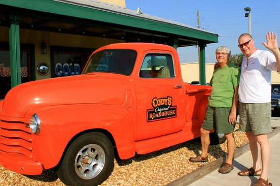 Cody's Roadhouse: Guys love the orange truck out front
