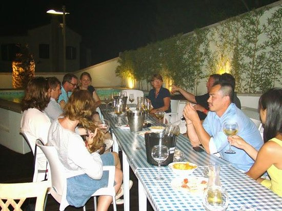 Villa Feniks: dining and drinking house wine by the pool with the other guests