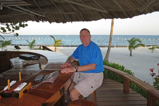 Turneffe Island Resort: Husband at the beautiful outdoor bar
