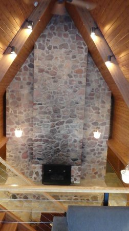 Canoe Bay: Fireplace in the library.