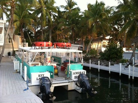 Amoray Dive Resort: The large dive boat, which docks right next to West building 1 rooms.