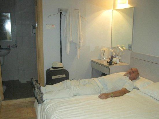 Fragrance Hotel - Selegie: Two coat hanger wardrobe and short bed, husband 5'4
