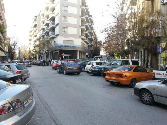 Hotel Olympia: The exterior of the hotel(?),all surrounded by tens of cars
