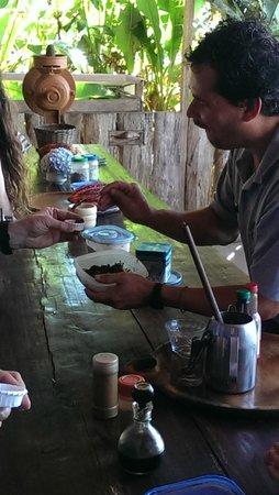 Don Juan Coffee Tour : Junior dishing out cocoa aka