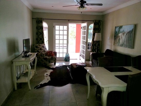 Accommodation at Van's: Spacious living area; swimming pool in the background