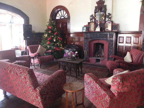 King's Cliff: Fireplace and piano adding to the charm