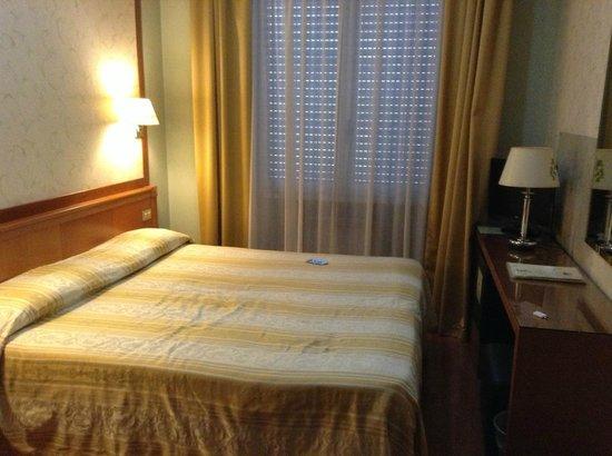 Eco-Hotel La Residenza: кровать