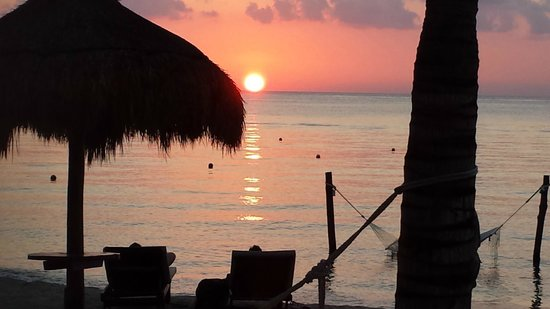 Secrets Aura Cozumel: sunset from our patio