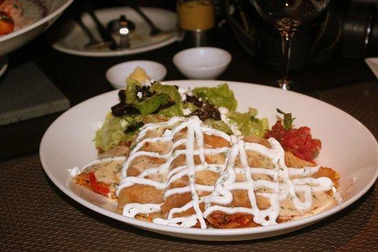 On The Rocks: Tortilla wrapped red kidney bean, pico de gallo, tortilla crush, sour cream,