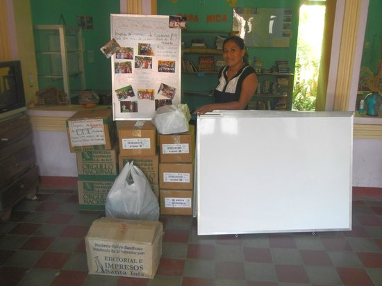 Casa Nica Spanish School : Vanesa, owner of the school, with school books and other supplies donated by Casa Nica School