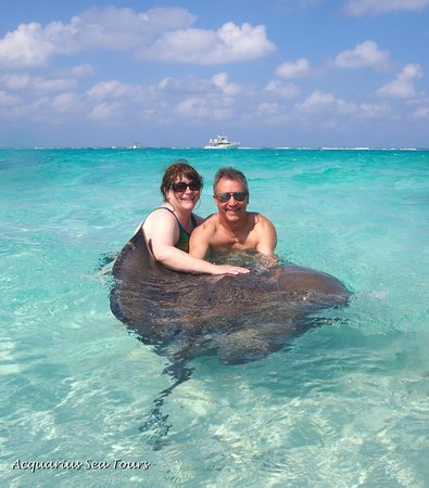 Acquarius Sea Tours : Hubby and I making friends at Stingray City