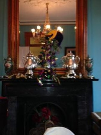 The Parisian Courtyard Inn: Fireplace mantel decorated for Mardi Gras
