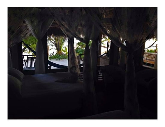 "Ahau Tulum : Room ""Life"". dark picture but you get the idea. very cozy and romantic"