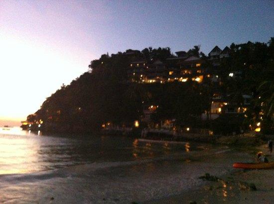 Nami Resort: Facade of Nami and other cliffside resorts at dusk