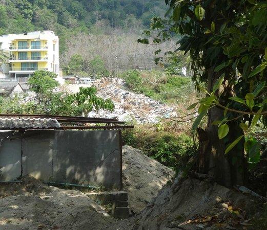 Thavorn Beach Village Resort & Spa: Rubbish dump view from hotel driveway!