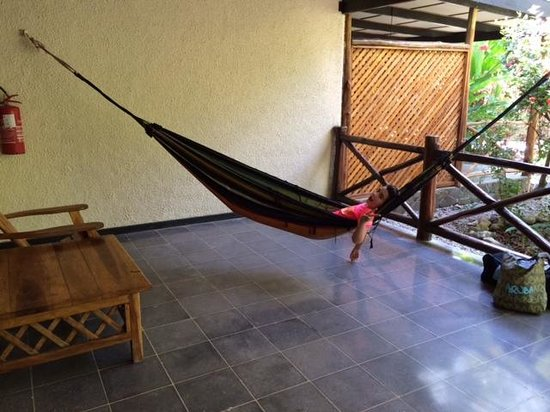 Hotel Tropico Latino: Large porch area with table, chairs and required hammock!
