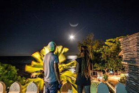 Coral Rock Zanzibar: My two mates ontop of our room balcony! Can you get a better night sky view??