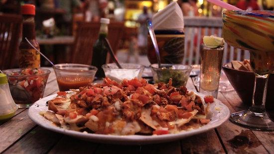Wet Wendy's Margarita House and Restaurant: 5 words.  Blackened Chicken Mango Chipotle Nachos