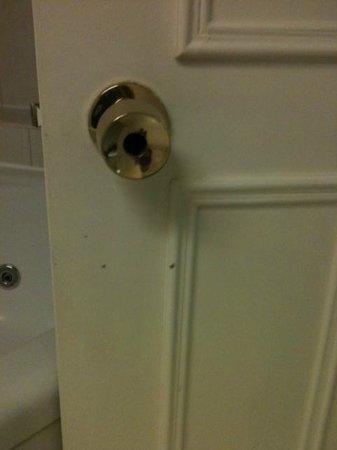 International Hotel: Scabby broken door handle... Poke finger right through