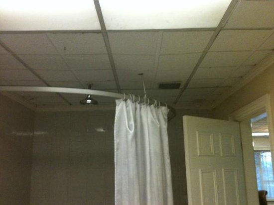 International Hotel: Bowed ceiling and mouldy shower
