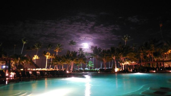 Now Larimar Punta Cana: Moon rising over main pool